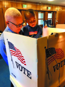 Mike Bonin votes with his son, Jacob at a CD 11 polling booth.